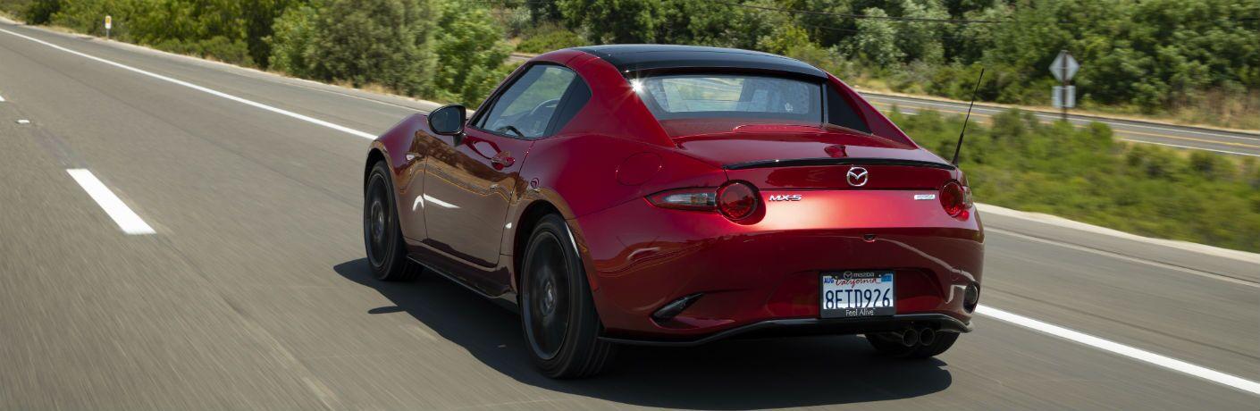 A rear photo of the 2019 Mazda MX-5 Miata RF on the road.