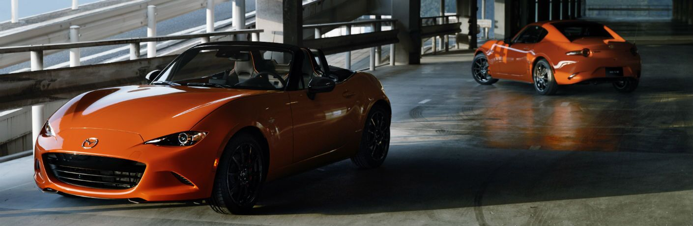 A photo of two versions of the 2019 Mazda MX-5 Miata 30th Anniversary Edition in Memphis, TN in a parking garage.