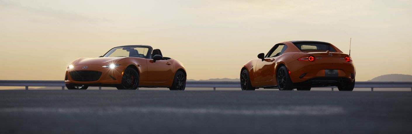 Another side-by-side photo of the two models of the 2019 Mazda MX-5 Miata 30th Anniversary Edition in Memphis, TN.