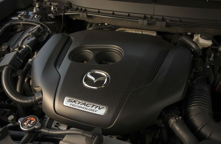 A photo of the engine used in the 2019 Mazda CX-5 Grand Touring.
