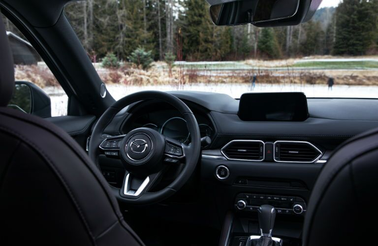 An interior photo showing the driver's cockpit of the 2019 Mazda CX-5.