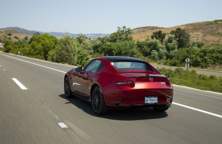 A rear photo of the 2019 Mazda MX-5 Miata RF on the road.