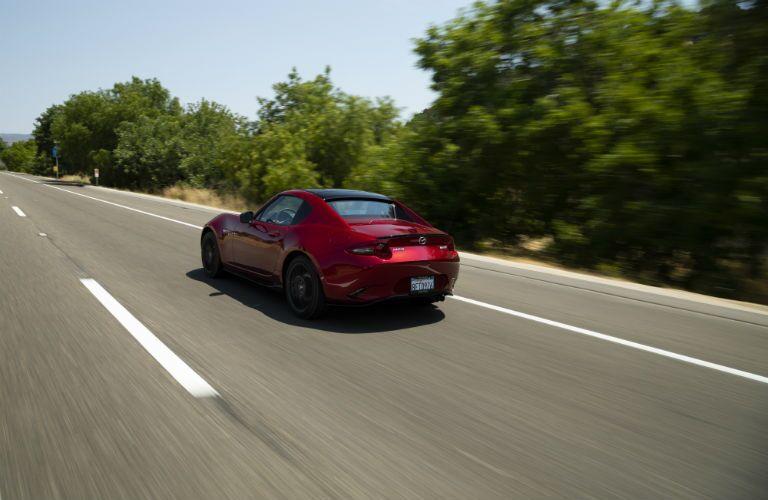 A rear left quarter photo of the 2019 Mazda MX-5 Miata RF on the road.
