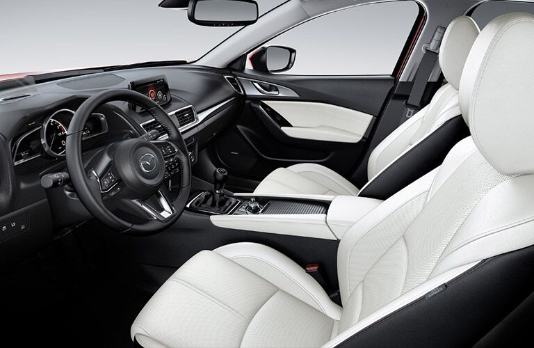 An interior photo of the front seats in the 2018 Mazda3.