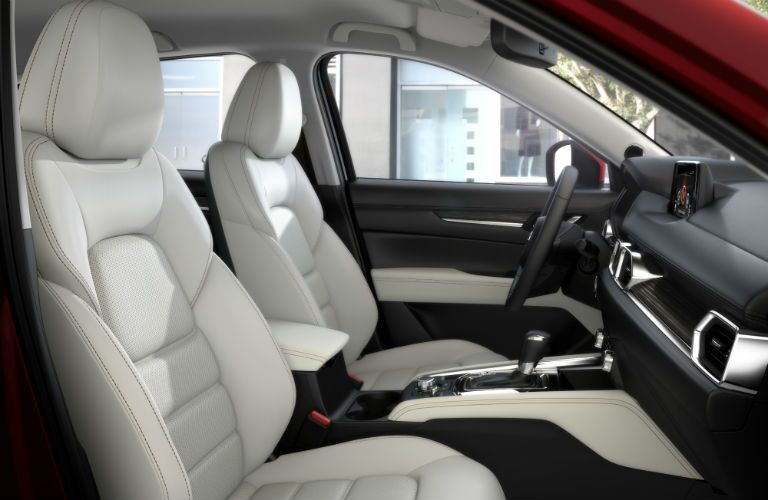 An interior photo of the front seats of the 2018 Mazda CX-5.