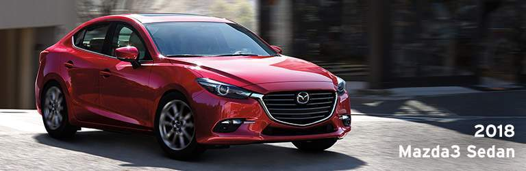 2018 Mazda3 Sedan Written in White with Exterior View of Mazda3 in Red