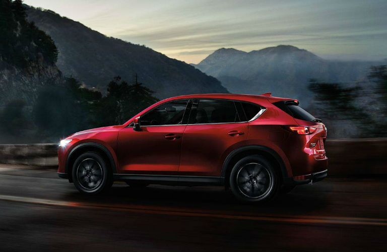 2018 Mazda CX-5 exterior drivers side profile on road with mountain background