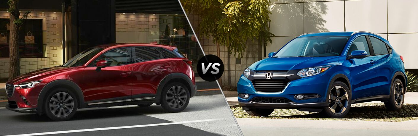 "Driver side exterior view of a red 2019 Mazda CX-3 on the left ""vs"" front driver side exterior view of a blue 2019 Honda HR-V on the right"