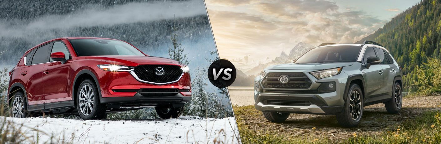 "Front passenger side exterior view of a red 2019 Mazda CX-5 on the left ""vs"" front driver side exterior view of a gray 2019 Toyota Rav4 on the right"