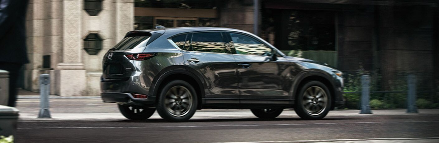 2020 Mazda CX-5 driving down a city street
