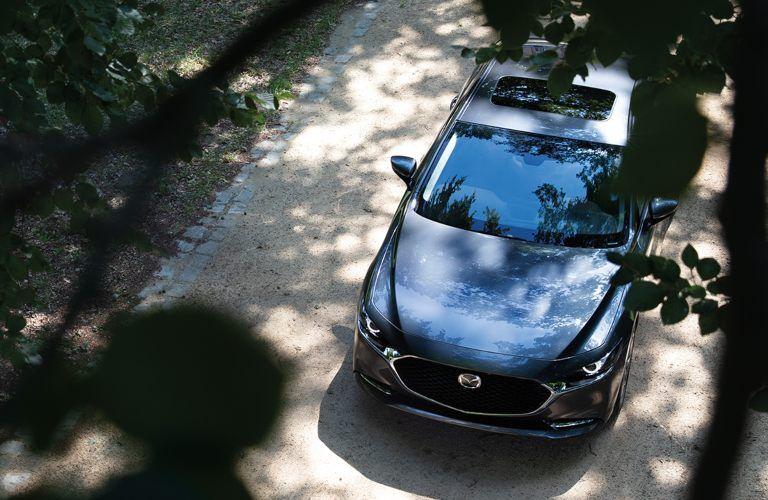 2020 Mazda3 Sedan driving down a rural road