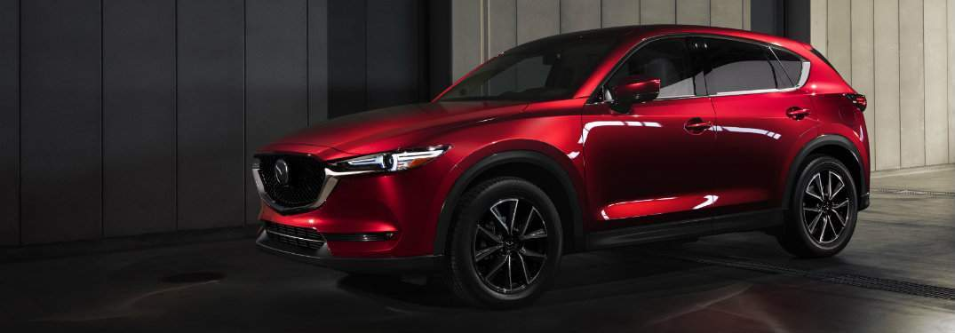 Red 2018 Mazda CX-5 parked in dimly lit garage
