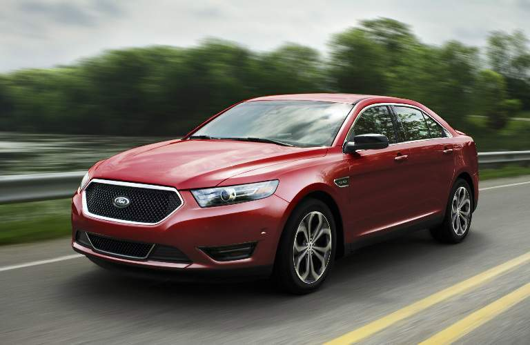 2017 Ford Taurus exterior view of front and left side in red