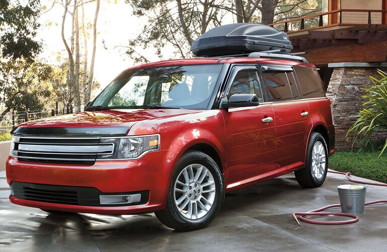 Red 2018 Ford Flex next to a Bucket and Hose