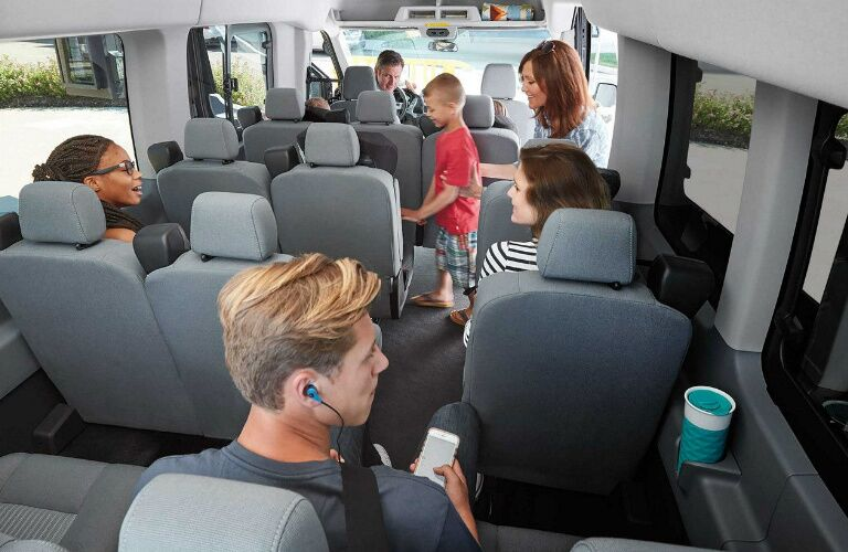 People Relaxing and Talking Inside of a 2018 Ford Transit Passenger Wagon