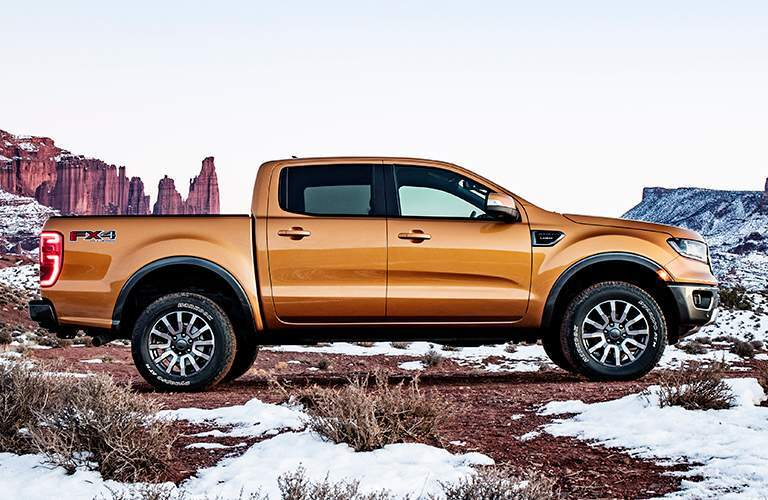 Side View of Orange 2019 Ford Ranger in Front of a Snowy Mesa