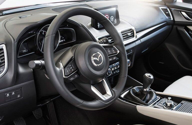 Interior of the 2017 Mazda3 Steering Wheel View in Black and Cream