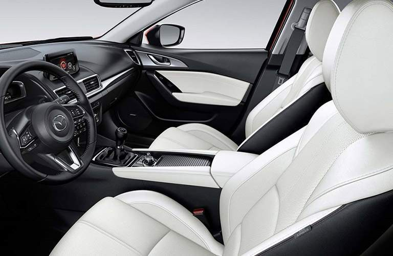 Interior View of the 2018 Mazda3 5-Door Front Seating in White