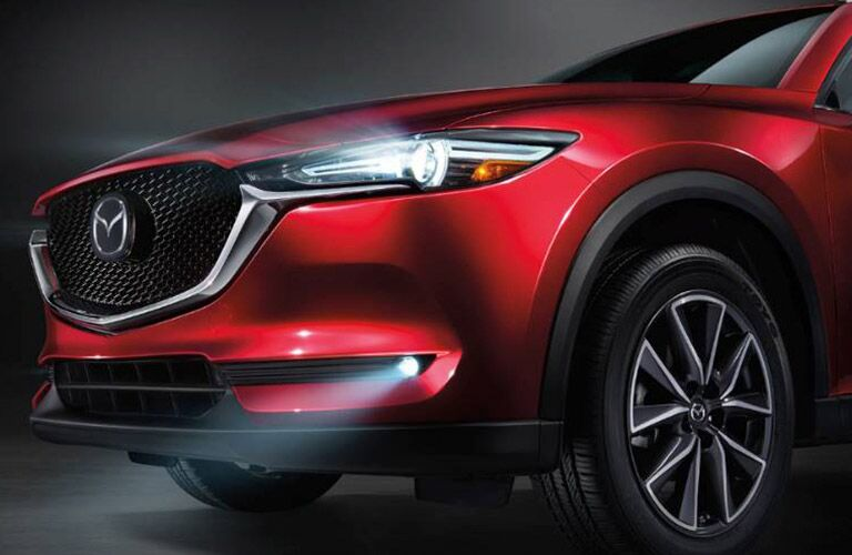 2019 Mazda CX-5 Front Diagonal View of Red Model with Headlights on
