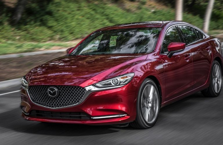 Red 2019 Mazda6 driving