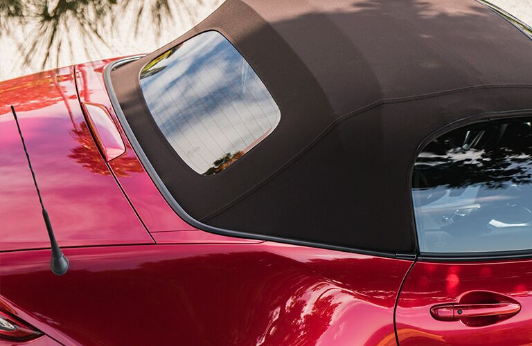 Overhead view of red 2019 Mazda MX-5 Miata with black soft top roof