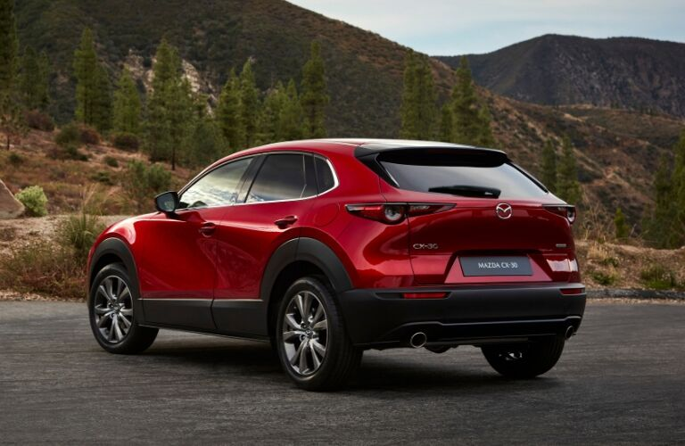 Rear exterior view of red 2020 Mazda CX-30