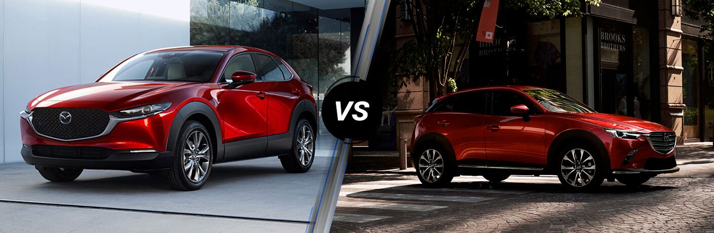 Front driver angle of a red 2020 Mazda CX-30 on left VS front passenger angle of a red 2019 Mazda CX-3 on right