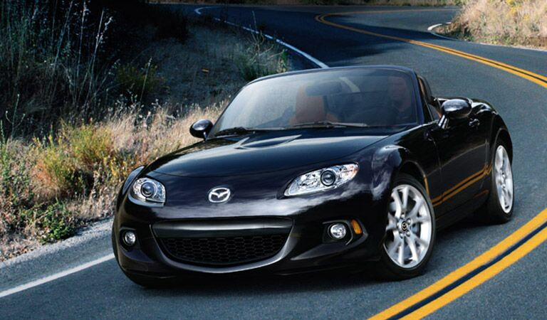 Mazda MX-5 Miata Driving Down Road in Black