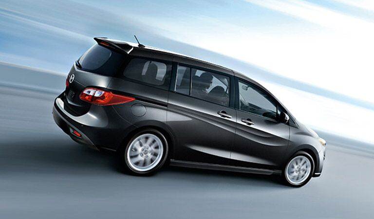 Mazda5 Driving Down Road Side Exterior View in Black