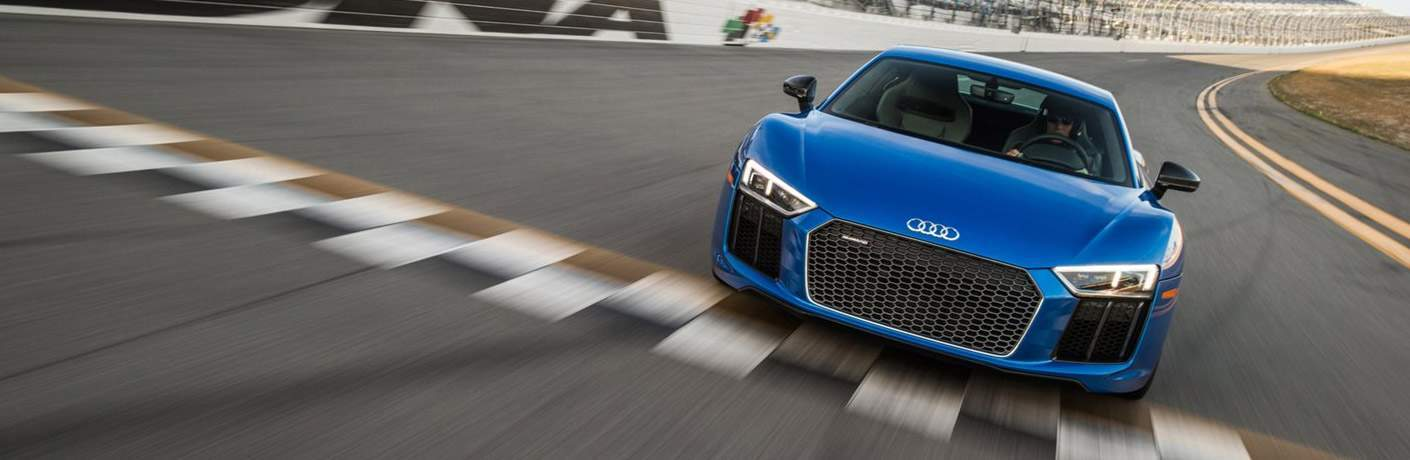 Audi Vehicle in Blue Being Driven on Racetrack