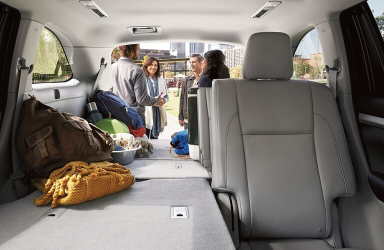 People Standing Behind the Cargo Area of a 2018 Toyota Highlander