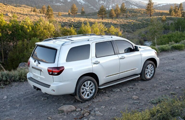 White 2018 Toyota Sequoia Driving on a Gravel Road