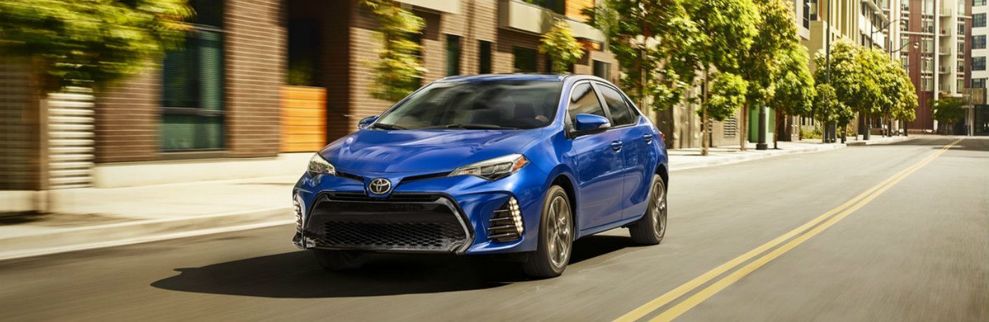 Blue 2019 Toyota Corolla Driving on a City Street