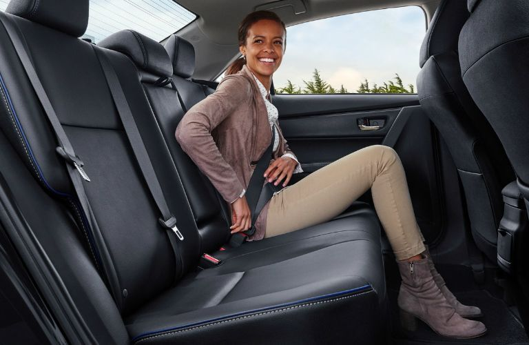 Woman Sitting in the Rear Seat of a 2019 Toyota Corolla