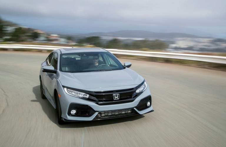 2018 Honda Civic Hatchback front view driving on highway