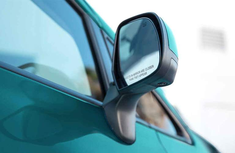 closeup of passenger side mirror on 2017 Nissan Versa Note