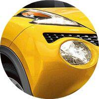 yellow 2017 Nissan Juke headlights closeup