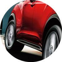 red 2017 Nissan Juke wheels closeup
