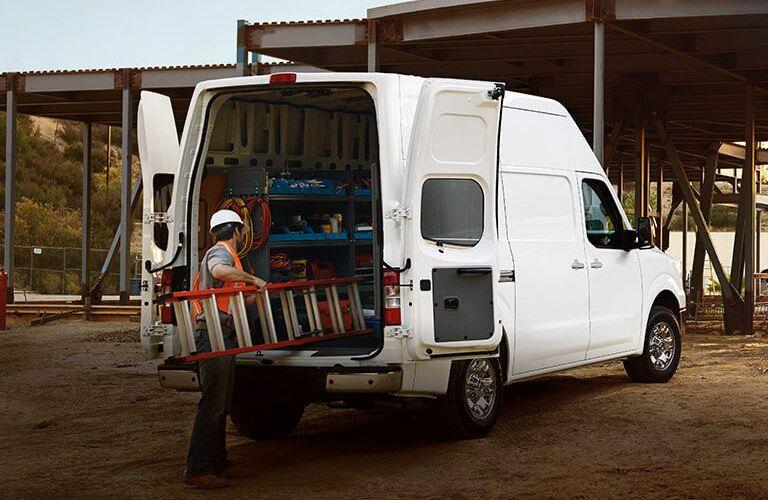 man loading ladder into 2017 Nissan NV Cargo