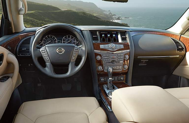 View of 2018 Nissan Armada interior with tan seating and steering wheel