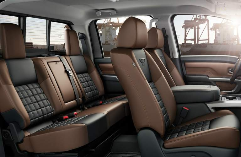 2018 Nissan TITAN interior view of tan seating in front and back