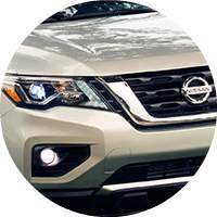 closeup of 2018 Nissan Pathfinder headlight plus foglight and front grille