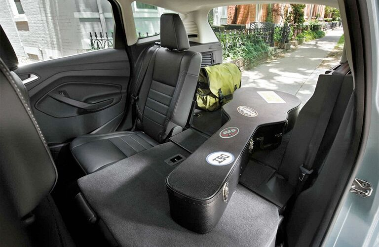 2018 Ford C-Max Hybrid interior looking at rear cabin 1 seat folded down with guitar in space and trunk open