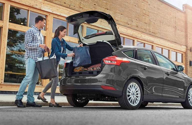 people loading cargo into ford focus hatchback