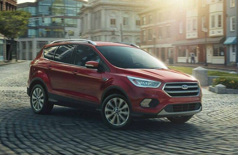 2018 Ford Escape parked in downtown city square