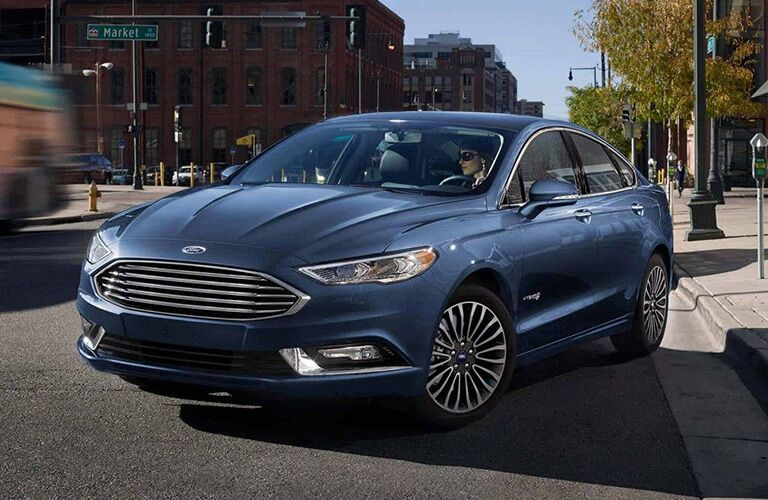 2018 Ford Fusion pulling away from a curb