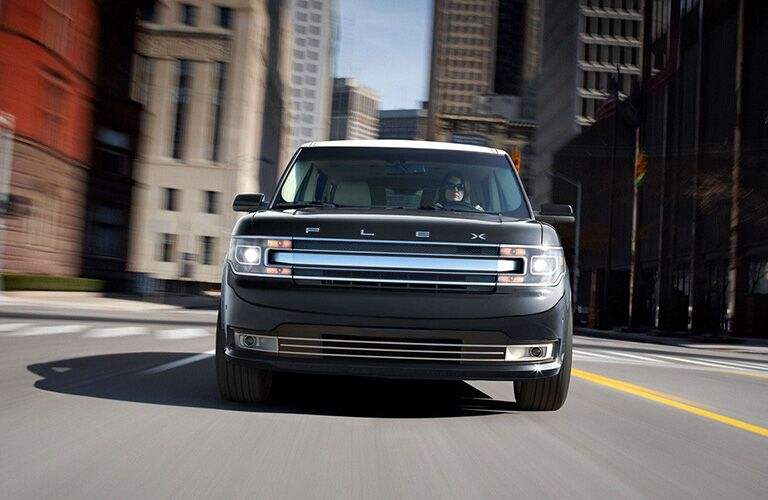 2018 Ford Flex exterior front fascia with female driver going fast on road