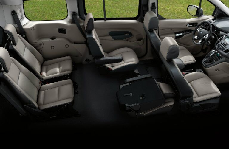 2018 Ford Transit Connect interior looking from ceiling down on seating with all rows up