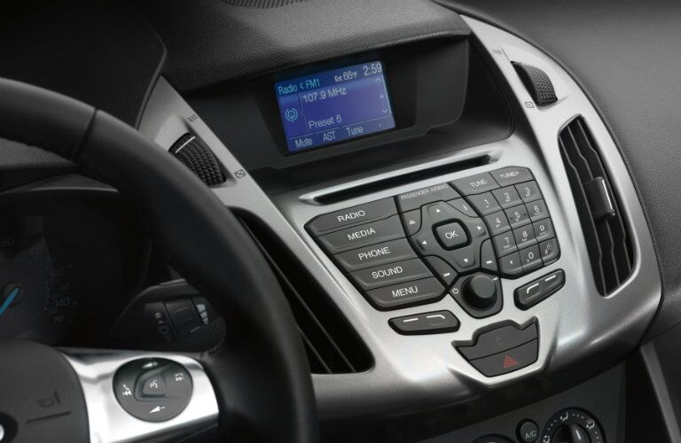 2018 Ford Transit Connect interior close up of partial steering wheel and touchscreen controls