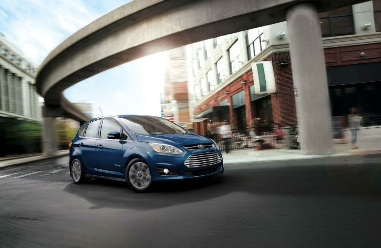 2018 Ford C-MAX Hybrid turning a corner by a cafe